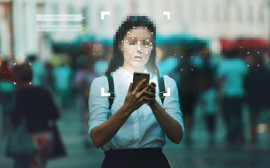 woman with blurred face on mobile phone with user id next to her